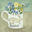 Rabbit cup with spring flowers